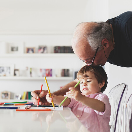 People indoor living room Grandfather help his child with drawing. Home, indoor, learning, people, improving people's lives, children, crayons, learning
