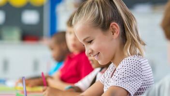 school, pupils, kids, school children, young girl, writing, pen, paper, class room, people, education, mirrored