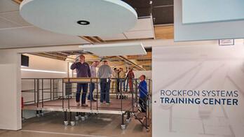 BE, Wijnegem Rockfon training center, installation room, photo wall and training center name