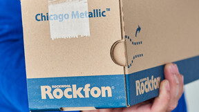 Rockfon Grid Box being held - Camera angle on the end of the box