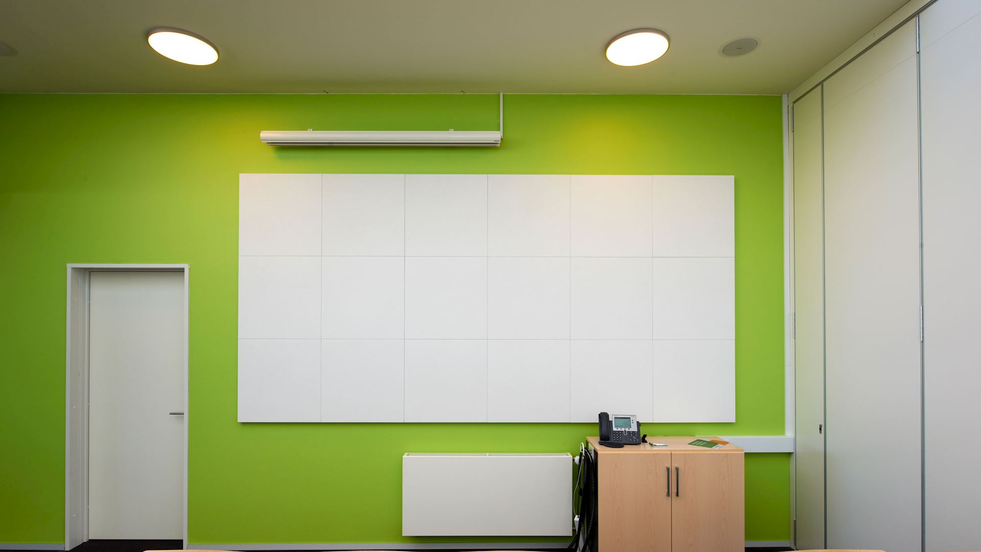 Acoustic wall panels with Rockfon Blanka Activity wall panel (designed for classrooms and open plan offices), super white painted fleece